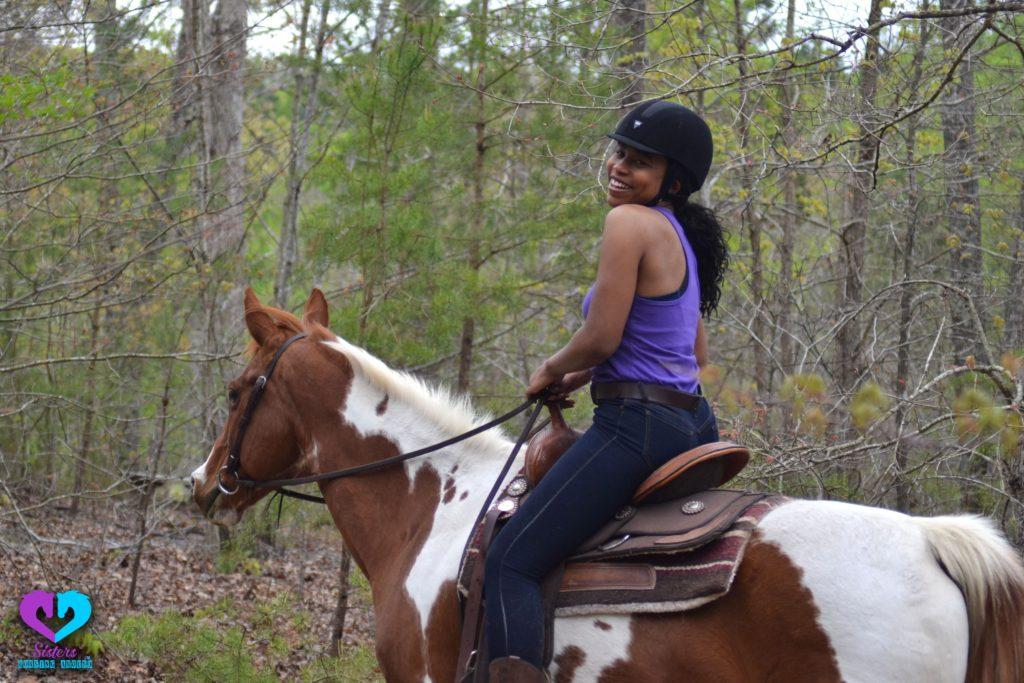 emily harris riding paint horse with helmet