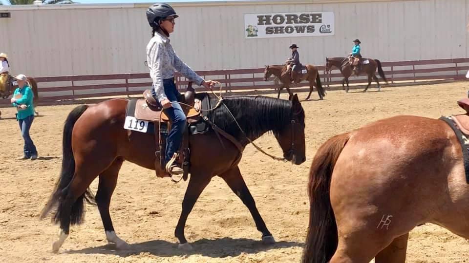 western horse rider wearing helmet