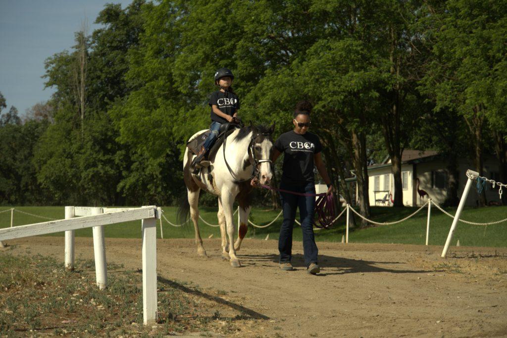 child riding horse