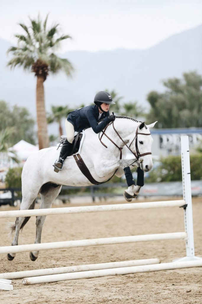 woman show jumping