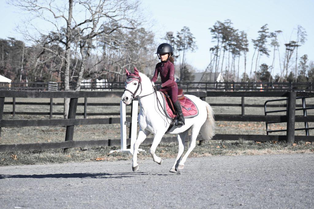child cantering pony