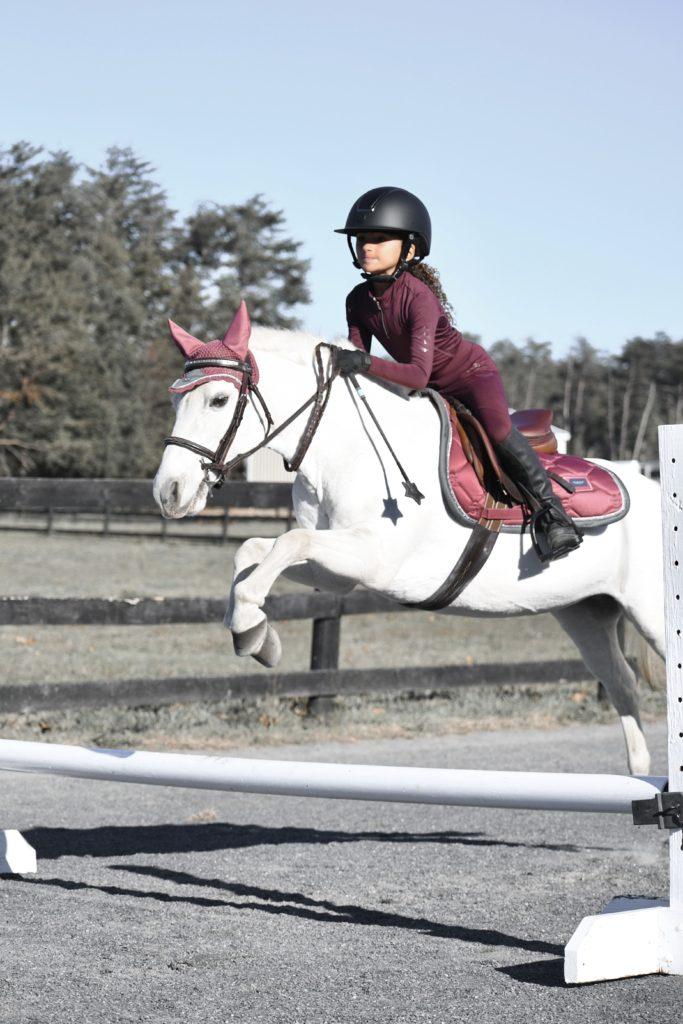 child jumping pony