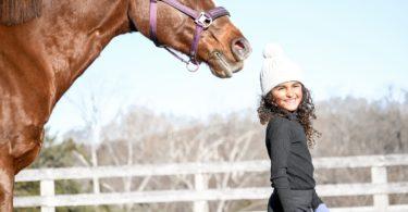 child bonding with horse