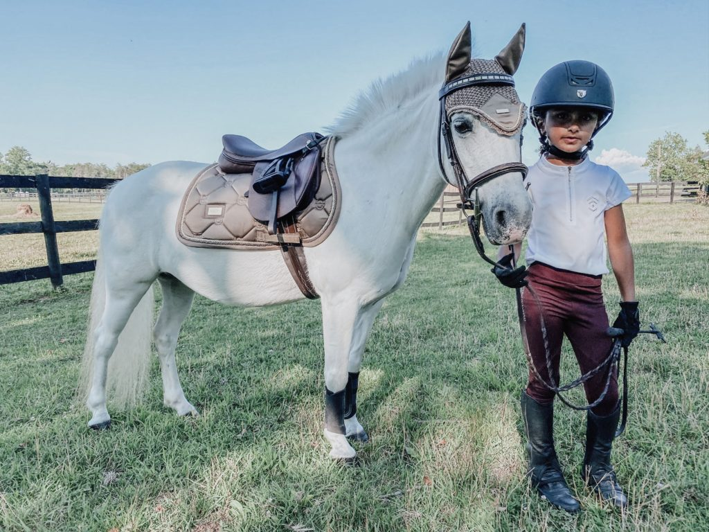 child riding lesson