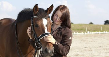 horse and girl dressage bridle